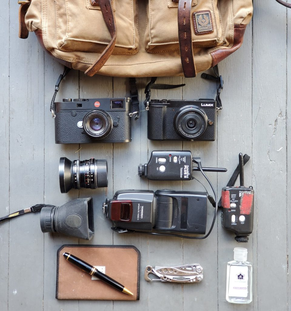 Camera gear laid out on the floor.